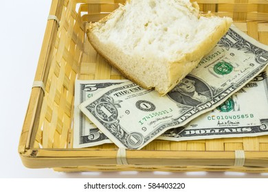 Basket with crust of bread and a couple of dollar bills