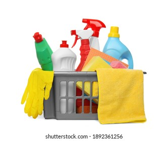 Basket with different cleaning products and tools on white background