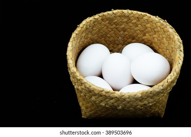 Basket of Duck eggs isolated on black background, Bamboo Container