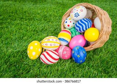 Basket of easter eggs  on Fresh Green Grass