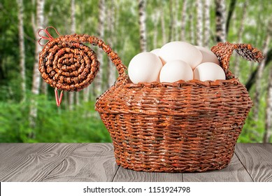 basket with eggs on a birchwood background