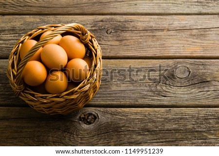 Basket Eggs On Old Wooden Background Stock Photo Edit Now