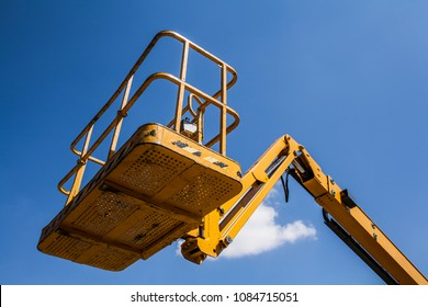The basket of elevator crane with sky background