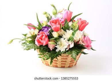 basket of flowers isolated on white background.