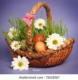 basket with flowers on blue background