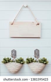 Basket flowers on color wooden background