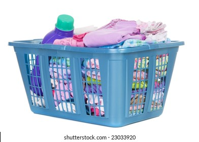 A basket of folded laundry. Children's clothes never end. Isolated on white