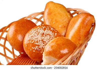 Basket of fresh baked rolls on white background