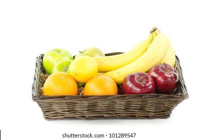 A basket of fresh fruit isolated on white.