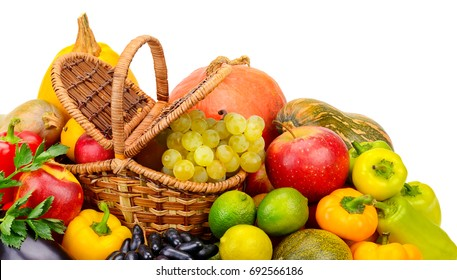 Basket with fresh fruits and vegetables isolated on white background. Top view.