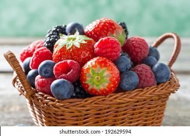 basket with fresh juicy berries, close-up, horizontal