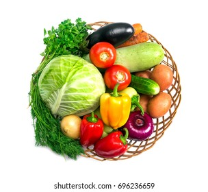 Basket with fresh mixed vegetables on white background