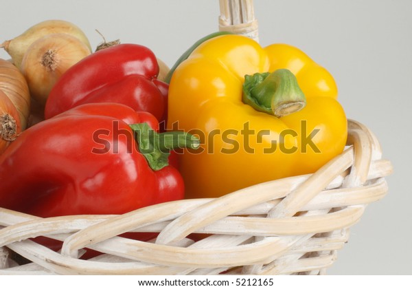 Basket with fresh peppers and onions