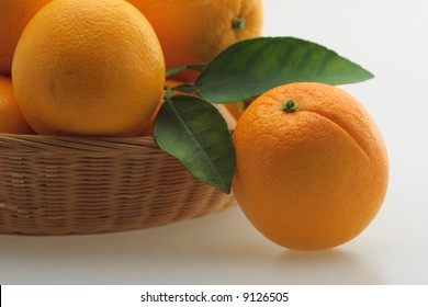 basket with fresh ripe oranges