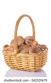 A basket with fresh saffron milk caps isolated on a white background