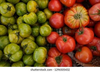 A basket of fresh tomatoes for sale at an Astoria, Oregon outdoor market.