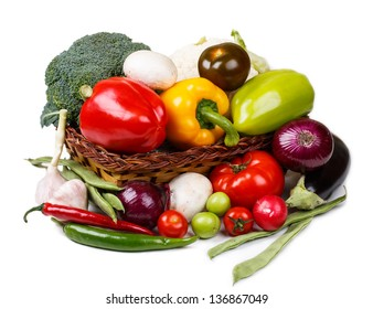Basket with fresh vegetables on a white background