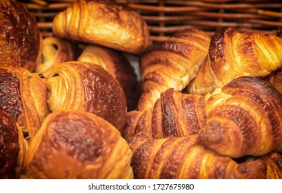 Basket of freshly backed croissants and chocolate croissants