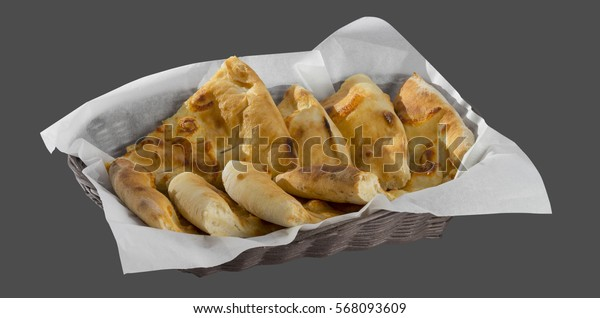 Basket with freshly baked loosening isolated on a gray background