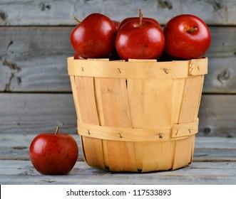 Basket of freshly picked red apples