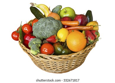 A basket of fruit and vegetables on white background.A basket of fruit and vegetables.