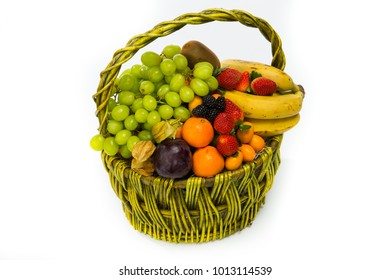 basket with fruits and berries, decorated with shiny flowers