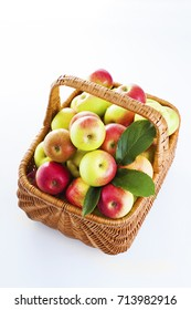 basket full of apples on white background - fruits and vegetables