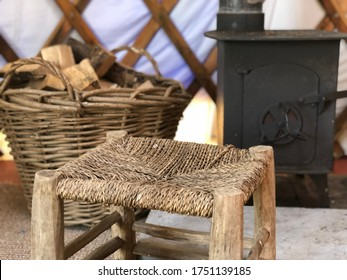 Basket full of Fire Wood, Rustic Wood Stove and Willow Chair; Traditional Scenery Indoor