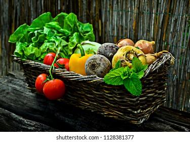 Basket full of fresh vegetables from the garden