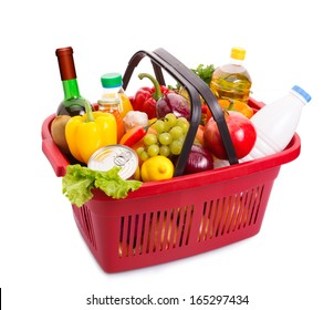 Basket full off fruits and vegetables. Food set. Isolated over white.