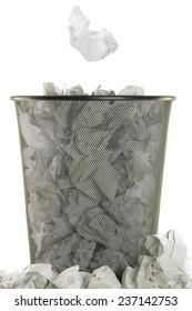basket full of white wastepaper on white background
