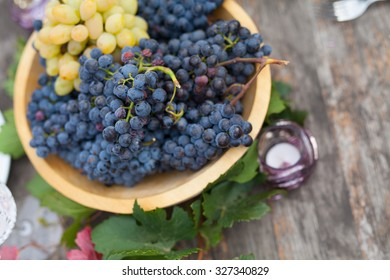 Basket of grapes is outside