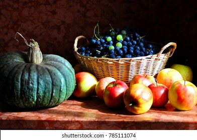 A basket with grapes, a pumpkin and apples resting on the kitchen countertop. The grazing light that comes in through the window. The Caravaggio's tribute was made.