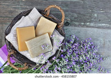 Basket with home made soap with lavender on wooden table