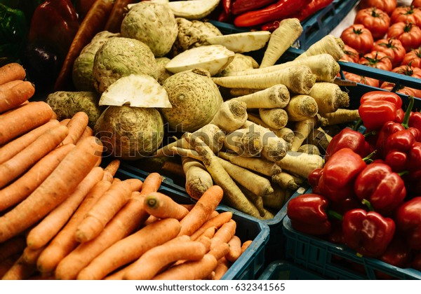 Basket with horseradish, radish, tomato, pepper, carrots on the farm market. Natural local products on the farm market. Harvest. Seasonal products. Food.
