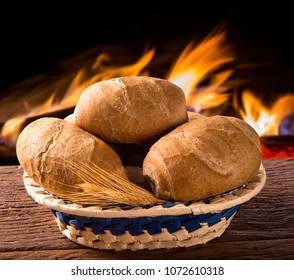 """Basket of """"Integral French bread"""", traditional Brazilian bread with fire background."""