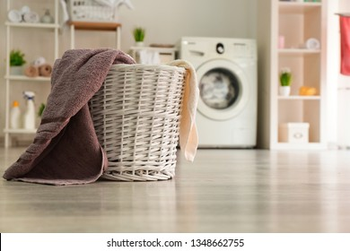 Basket with laundry in room