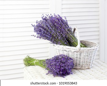 Basket with a lavender over white shutters. Lavender flowers in closeup.