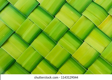 basket making, zigzag weave of palm leaf, green foliage interlace texture, abstract nature background