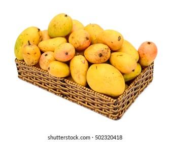Basket of mangoes on white background