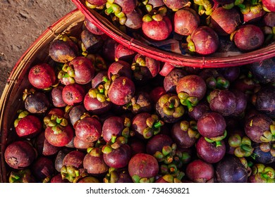 A basket with Mangosteen fruits at a street market, Vietnam