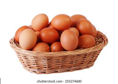 Basket with many eggs isolated on white background