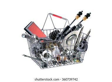 Basket with many spare parts for the passenger car. Spare parts for shop, aftermarket, OEM. Spare parts, auto parts in basket. New spare parts for shop. Many auto spare parts for car. Painted basket.