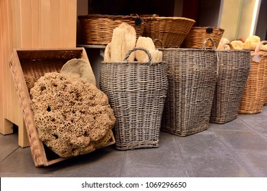Basket with natural sea sponges and loofahs for the bath. A small shop on the street of Corfu. Greece.