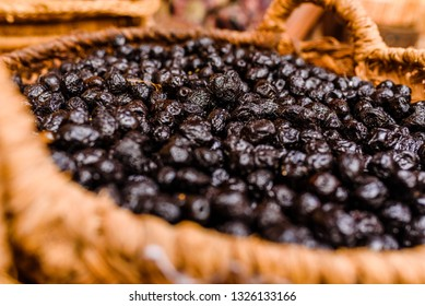 Basket with nutritious dried black olives, snack typical of the Mediterranean countries