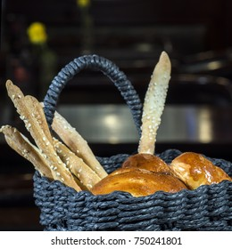 Basket with pies and bread sticks with sesame