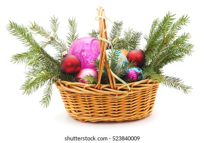 Basket with presents and tree isolated on white background.