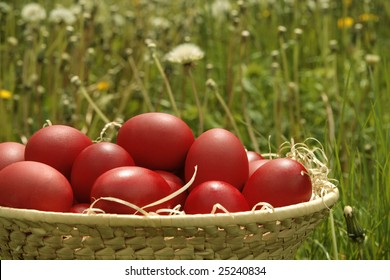 Basket with red Easter eggs on blurry background