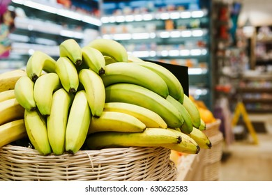 Basket with ripe bananas on sale in grocery food store.Buy banana for healthy eating.Tasty natural exotic fruit from tropic farmer market.