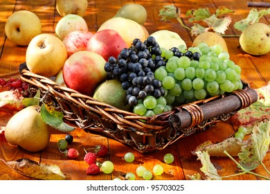 Basket of ripe fruits on the table.